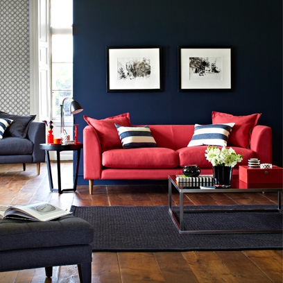 5 1375694153 rich blue walls and red sofa with dark wood floors  square