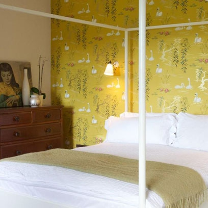 Mustard Yellow Patterned Wallpaper In Bedroom