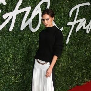 Victoria Beckham merges fashion lines