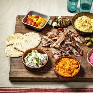 Slow roast duck with Middle Eastern mezze