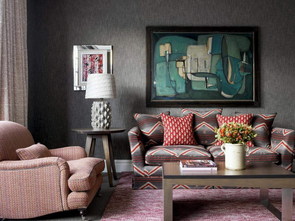 A Ralph Lauren Printed Navajo Fabric Called Sacred Mountain On The Sofa Works With An Abstract Painting Stone Lamp By Porta Romano