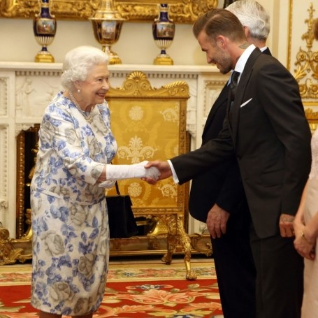 Here's the Queen fangirling over David Beckham