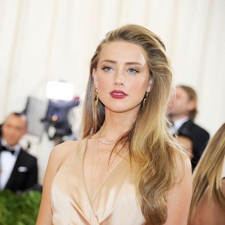 Amber Heard appears in an emotional domestic violence campaign video