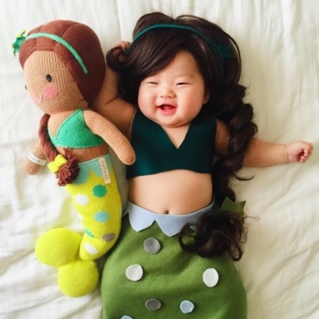 This baby is the queen of dressing up