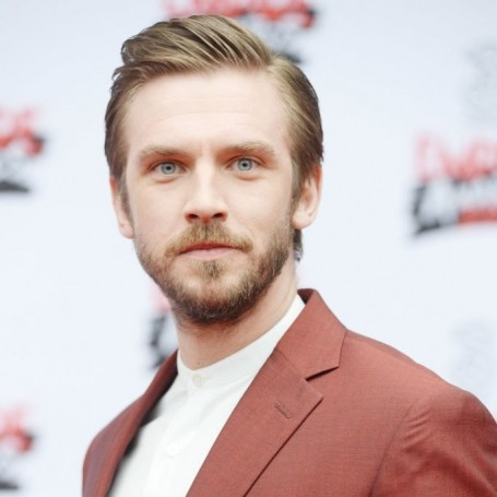 Prepare to swoon over Dan Stevens in a sleek red suit