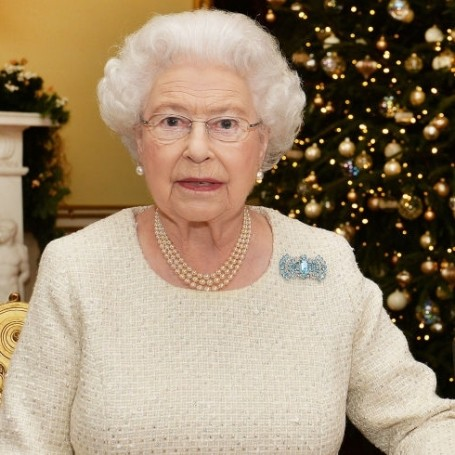 This photo of 'the Queen' wearing a corgi Christmas jumper is everything