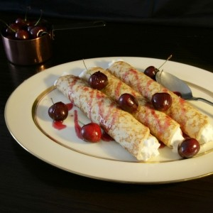 Pancakes with chantilly cream, black cherry and kirsch sauce