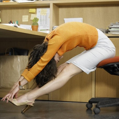 5 stretches you can do at your desk to help back pain