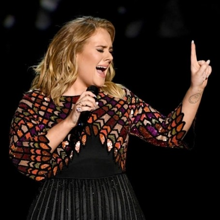 Adele visits Grenfell Tower firefighters for a cup of tea