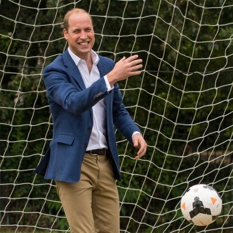 Watch adorable video of Prince William getting beaten by little girl during football