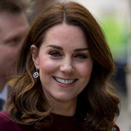 Kate Middleton looks glowing as she bonds with fellow pregnant mums