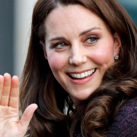 Duchess of Cambridge rocks a festive maternity coat for a Christmas charity party