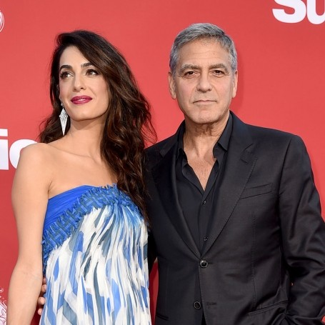 George and Amal Clooney hand out headphones on flight to apologise in advance for twins