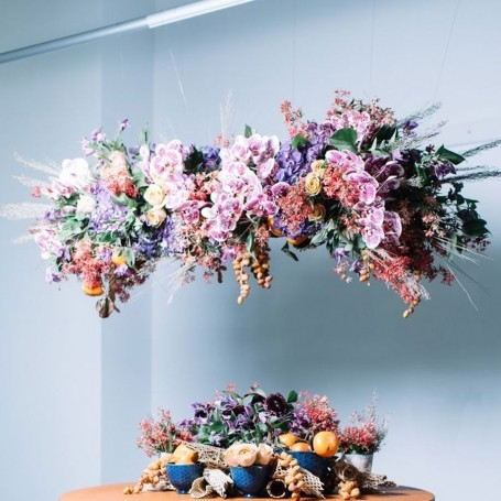 Trend alert: flower walls are out, floral chandeliers are in
