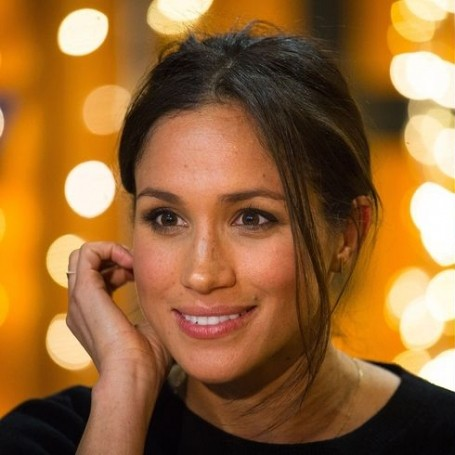 Body language experts reveal why Meghan Markle is always touching her hair