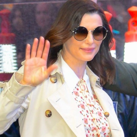 Rachel Weisz flaunts her baby bump in a beautiful floral dress